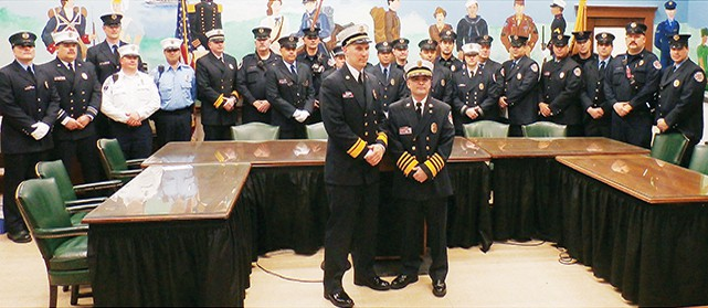 he proud members of the fire department pose with their new Fire Chief Abraham Pitre