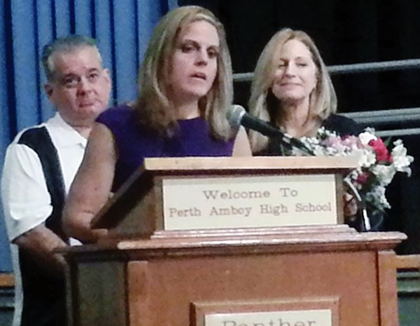 PERTH AMBOY – The 10/16/14 Board of Education recognized the Teachers of the Year in each school. Dawn Bishop-Wistreich of the James J. Flynn School was the Teacher of the Year for that school and also was recognized as the 2014-2015 District Teacher of the Year. In her acceptance speech she recognized all the teachers who won the honor for their schools, her administrators and lovingly thanked her family who was in attendance for their support. (L to R) Principal of Flynn School John F. Cilia, Dawn Bishop-Wistreich and Acting Superintendent Dr. Vivian Rodriguez