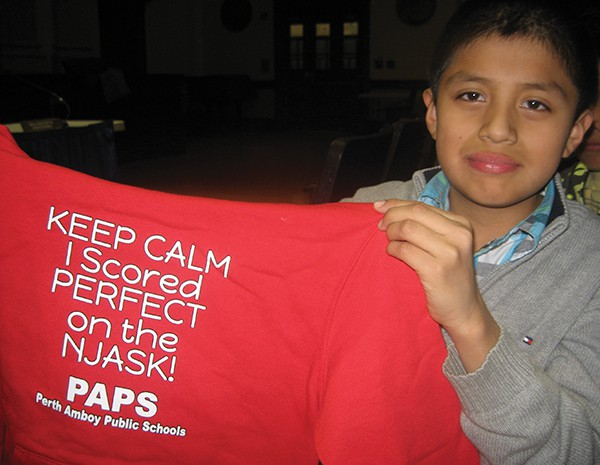 Robert Sanchez Tlantpa was one of 120 Students who achieved a perfect score on the 2014 NJ Assessment of Skills and Knowledge (NJSAK) statewide test in the Perth Amboy School System. The students were honored with T-shirts and flowers.