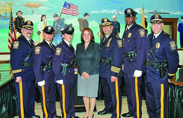 Police Chief Benjamin Ruiz, third from right, at swearing-in ceremony for police officers in June 2014.