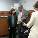 Mickey Gross is sworn in by Middlesex Co. Surrogate Kevin Hoagland. Gross' wife, Sue hold the bible.