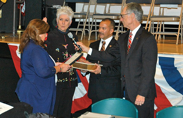 Lisa Nanton is sworn in as Council President by City Clerk Elaine Jasko. Joel Pabon whom Nanton succeeded as President holds the Bible while City Attorney Mark Blunda holds the mic. *Photo by Paul W. Wang