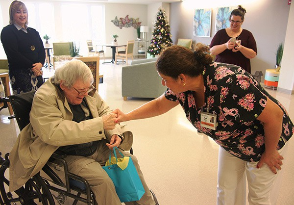 SOUTH AMBOY - One of the first Residents at Venetian Care & Rehabilitation Center in South Amboy, Larry Weghorn, is greeted by his care partner Ayde Ruiz today as Windsor Healthcare Vice President Batsheva Katz (L) and Venetian Administrator Gina Kirchoff, (R) look on.    *Photo Submitted