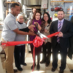 Cutting the Ribbon (L to R) Ana Zevallos, Owner Marcell Ysaac and his Mom, Mayor Diaz, UEZ Coordinator Roxana Troche, Jason Conway VP Area Manager Provident Bank and Sergio Diaz BID Board Member and Manager of 1st Constitution Bank.