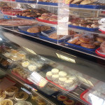 Display case of cakes, pastries and meats for sandwiches