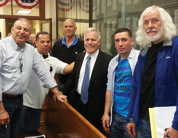Former City Council Candidate Miguel Nunez (Far Left) Community Activist Alan Silber (Far Right) along with others surround Fernando Gonzalez (3rd From Right) who they supported in the   May 12, 2015 Special Election where Gonzalez won the last seat on the City Council.