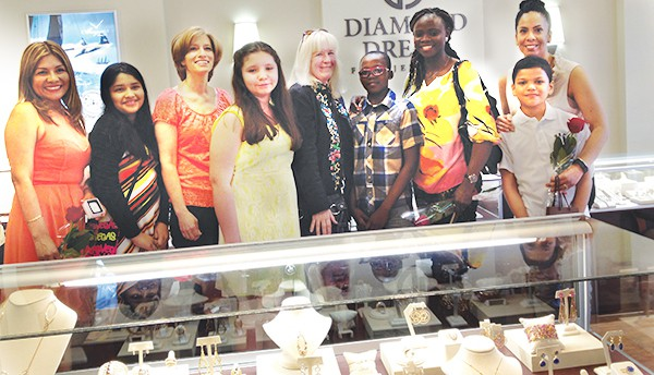 """Press Release 5/11/15 PERTH AMBOY - Four Perth Amboy Catholic School Students won precious jewels in the Diamond Dream Fine Jewelers Essay contest for Mother's Day.  Mr. & Mrs. Edward Shapiro of Diamond Dream Fine Jewelers in Bernardsville, N.J. asked elementary school students to write an essay entitled """"My Mom Shines Like a Diamond."""" Perth Amboy Catholic School, under the direction and guidance of Rose Pennyfeather and Sr. Rebecca Piatek had 4 student essay winners out of the 10 essays chosen from Middlesex, Somerset, Hunterdon, Morris and Union counties. The winners were Damilola Borishade, 2nd place, (Diamond), Katelynn Barcheski, (Garnet), Nicole Rosas-Bendrell (Peridot) and Joel Sierra (Garnet). The students and their mothers attended the Award Ceremony on Saturday, May 2nd at 3 p.m."""