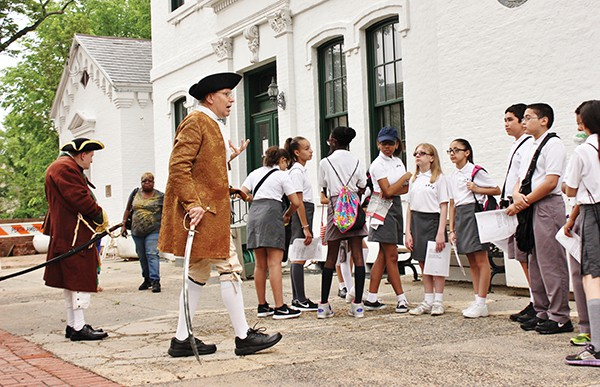 Anton Massopust (as a Revolutionary soldier) informs students about Perth Amboy being the Colonial Capital of New Jersey. John Dyke portrays William Dunlap.