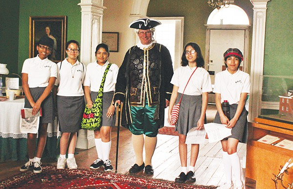 Kurt Epps as Royal Governor William Franklin & Perth Amboy Catholic School students in the center hall of the Proprietary House.
