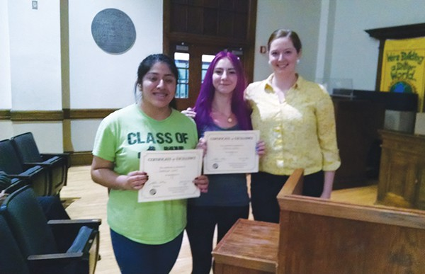 """Rebecca Salerno and Guadalupe Lopez were present at the 6/18/15 Board of Education Meeting with teacher Meghan Reeves. They were presented with a certificate in honor of their work on the Short Film: """"Forgotten.""""                    *Photo by Katherine Massopust"""