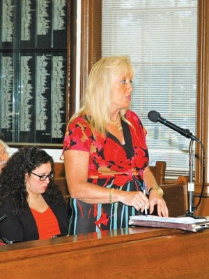 Susan Batista reads a statement at the public portion of the 8/10/15 City Council Meeting *Photo by Paul W. Wang