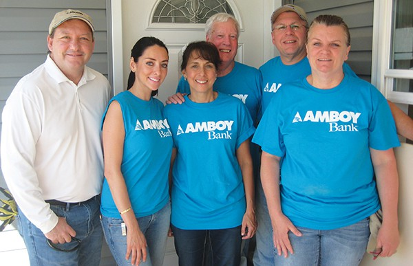 News Release SOUTH AMBOY - As part of the NJBankers Build Initiative, Amboy Bank employees helped restore a Lake Como home that was damaged by Hurricane Sandy and is being rebuilt by Coastal Habitat for Humanity. Amboy employees from left to right: Gregory Scharpf, Sylvia Rapoport, Gloria Dumm, Dennis Kane, Stanley Koreyva and Annelie Kulcsar. Amboy Employees spent the day at the home installing hard wood flooring. In addition to employees volunteering their time, Amboy Bank made a $1,000 contribution to Coastal Habitat for Humanity to help them restore the dozens of homes that they are working on along the Jersey shore.