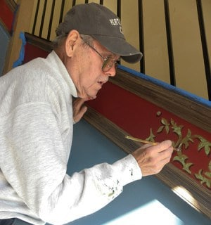 Tom Ward paints the foyer in City Hall *Photo by Noelia Colon