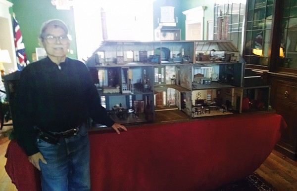 Artist Tom Ward poses next to a doll house he made on display at the Proprietary House. Photo taken on 10/4/15. *Photo by Katherine Massopust