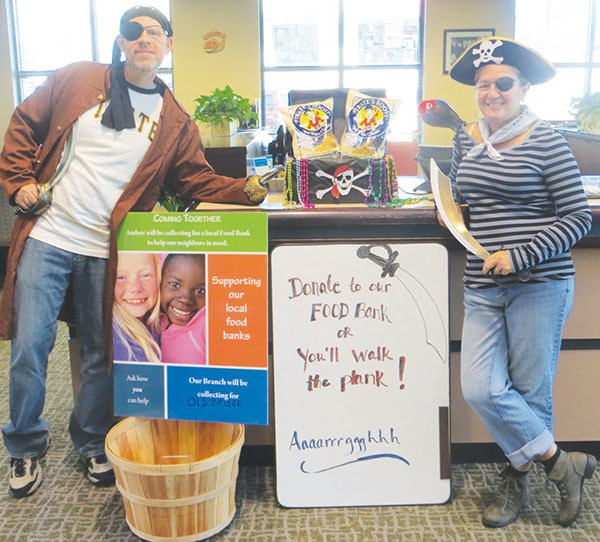 Amboy Bank Sayrewoods office bankers become pirates for the day during Amboy's Halloween kick off of its annual bank wide food drive. All offices will be collecting food during November.*Photo submitted by Amboy Bank