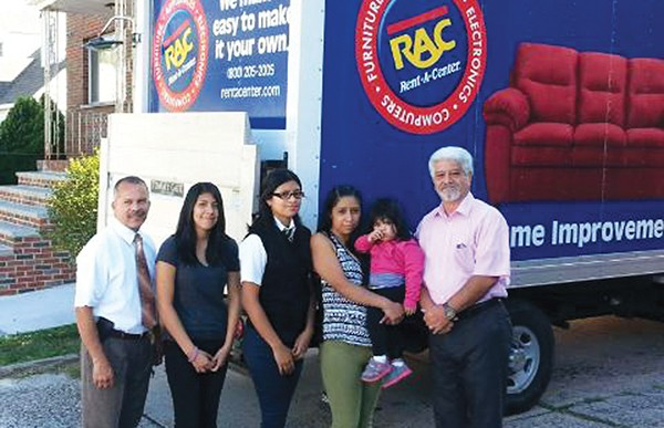9/23/15 - Councilman Joel Pabon, Aguilar family and Louis Mercado, store manager for Rent a Center donating furniture to needy family in Perth Amboy.