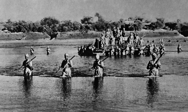 Indian troops in World War II cross the Atbara river with their motor transport on a pontoon raft, as they move into Italian occupied Eritrea. ww2today.com