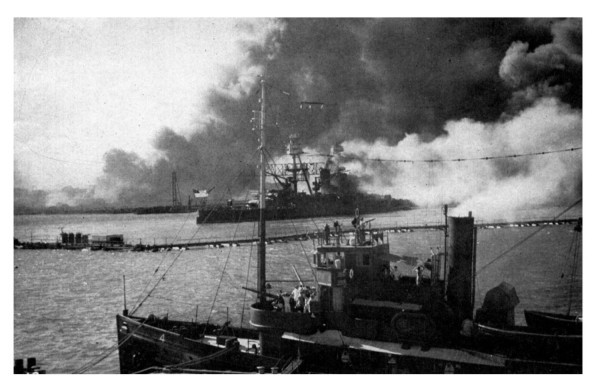 The U.S.S. Nevada smokes after being attacked by Japanese fighters. In foreground is a U.S. tug boat. clipart.com