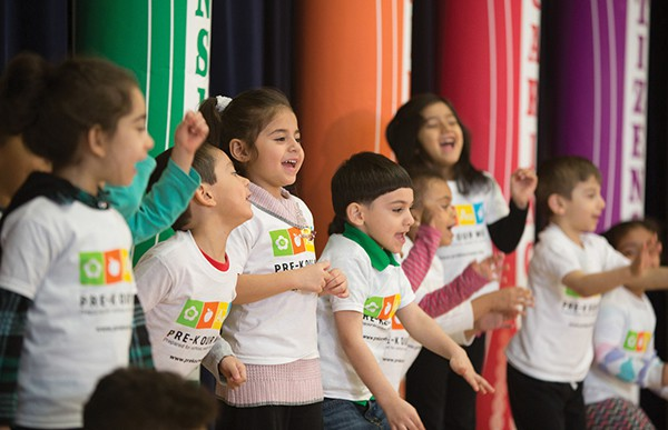Miss Melody Bioletti's class of 4-year old preschool students from Clifton Early Learning Academy, Clifton School #17 sing for attendees at an announcement event of legislation that would expand preschool access to more three- and four-year olds in New Jersey.
