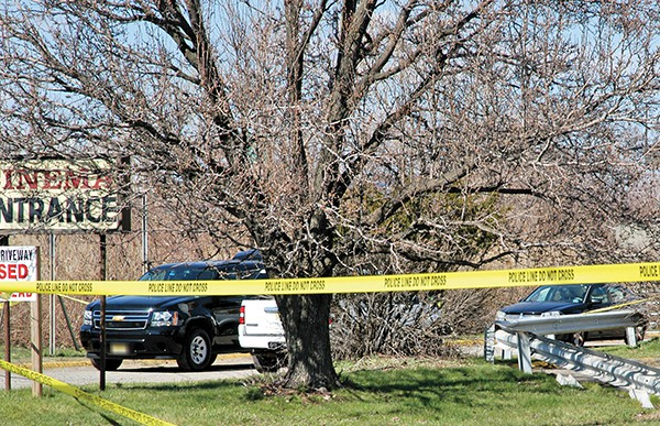 The Crime Scene: Note the shattered window on the vehicle.