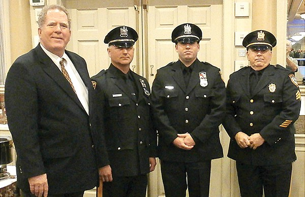 Last year he was one of three Sayreville Police Officers honored by the 200 Club of Middlesex County. He is the Officer pictured in the middle of the photo. Officer Kurtz was a nine year veteran of the force and recently promoted to Detective. Photo by Joe Bayona.
