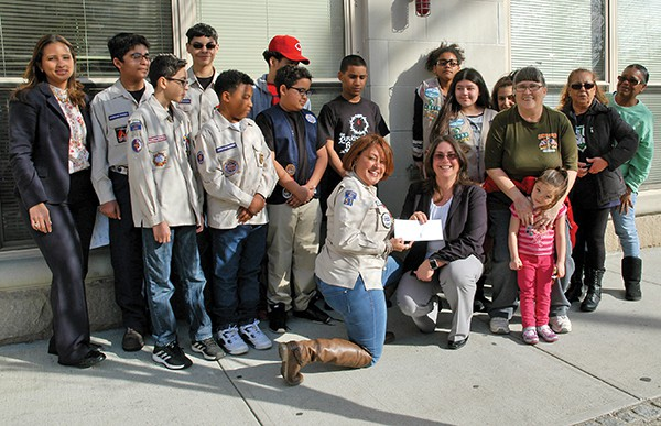 The Girl Scouts and Royal Rangers pose for photos at the Kearny Cottage. A check was presented from the The Eddie and Brenda Trujillo Family Foundation to help with the project. More pictures below. *Photos by Paul W. Wang
