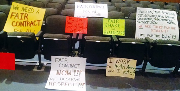 Signs on display on seats in the auditorium in PAHS where the Board of Education took place.
