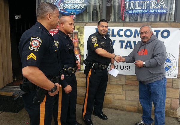 Harry Scheman presents a check for Project Lifesaver