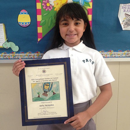 Press Release PERTH AMBOY - Sofia Hernandez, a 4th grade student at Perth Amboy Catholic School, won Honorable Mention in the 2016 International Aviation Art Contest. Sofia received a certificate and copy of her winning entry from The State of New Jersey Department of Transportation, Bureau of Aeronautics. Her winning entry was sent in by her Art Teacher, Rose Pennyfeather. For further information, please contact Rose Pennyfeather at Perth Amboy Catholic School at (732) 826-1598.