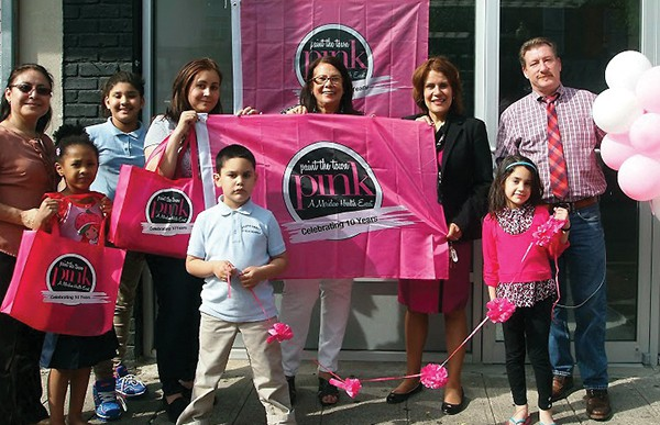 """Press Release PERTH AMBOY - The Downtown Business Improvement District (BID) and Meridian Healthare creating the City's first """"Paint the Town Pink"""" event. During May, Perth Amboy is brightening its downtown with pink bows and signs to remind everyone that early detection is the best defense against breast cancer. """"Paint the Town Pink"""" raises awareness about women's health issues, the importance of breast health screenings, and gathers donations for women with scarce resources to get an annual mammography. Mayor Wilda Diaz recently visited the Birmania Salon, 188 Smith Street; Paramount Properties, 184 Smith Street; and Alameda Center for Rehabilitation and Healthcare, 303 Elm Street, to provide these """"Pink Partners"""" with materials provided by Meridian Health. Shown in the photo with """"Paint the Town Pink"""" signs, bows, and tote bags are from left to right: Executive Director of the BID Roxana Troche, Birmania Paulino, owner of Birmania Salon (center of photo), Mayor Wilda Diaz, and James Synder of Paramount Properties, who is on the BID Board. There is still time become a """"Pink Partner,"""" by contacting BID's Roxana Troche by phone: 734.442.6421 or emailing at rtroche@perthamboynj.org."""