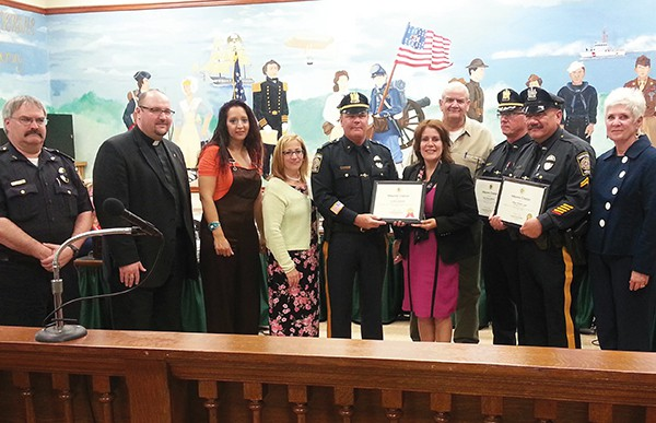 Members of the PAPD being honored 5/11/2016 (L to R) Deputy Police Chief Larry Cattano, Police Chaplains, A Resident received help from Police, Pastor Bernadette Falcon-Lopez, Lt. Paul Cannamela, Mayor Diaz, Police Chaplain Gregory Pabon, Capt. Roman McKeon, Officer Willie Lopez. There was communication stating Pastor Bernadette Falcon-Lopez of God's Army Ministries of NJ commending the following Police Officers for not only doing their job daily to protect and serve, but also for going above and beyond the call of duty through an act of charity they perform during the annual Point-In-Time survey. Besides the Officers above, Officer Henry Rodgers and Lt. Steven Killane (not pictured above) were also commended.