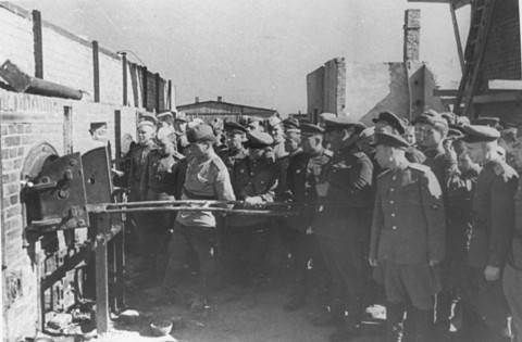 Nazis watch a demonstration of the ovens at Majdanek concentration camp in Lublin, Poland.