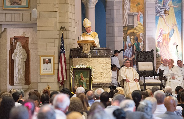 Parishioners listen attentively as Bishop James F. Checchio delivers the homily