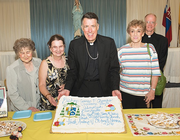 Presentation of the cake given to Bishop Checchio in appreciation for his accepting an invitation to celebrate Mass at Holy Trinity Church. (L to R) Marie Dillman, Christine De Hanes, Bishop James F. Checchio, Barbara Skokan and Msgr. John Gordon.