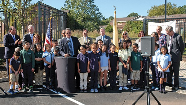 Students from Flynn Elementary School were present during the announcement