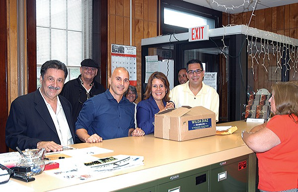 The Stronger Team (L to R) Tony Cruz, supporter of Mayor Diaz and her slate, Gregory Pabon (rear) and Candidates Jelmin Caba, Mayor Wilda Diaz and Councilman Fernando Irizarry submit petitions to City Clerk Elaine Jasko. *Photo Paul W. Wang