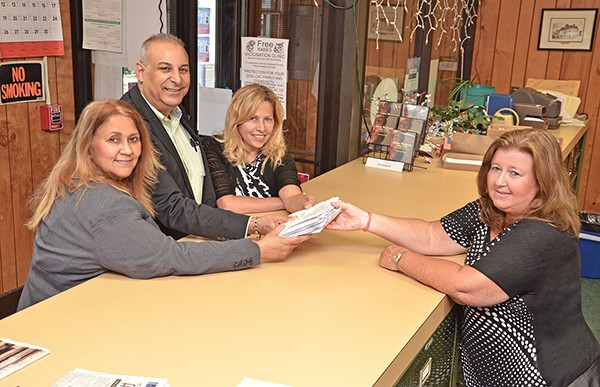 The Miguel Nunez Slate. (L to R) Virginia Lugo, Miguel Nunez and Miriam Quiles submit their petitions to City Clerk Elaine Jasko *Photo by Gabriel Pena