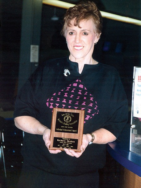 Barbara M. Skokan with an award from the NJ State Women's Bowling Association