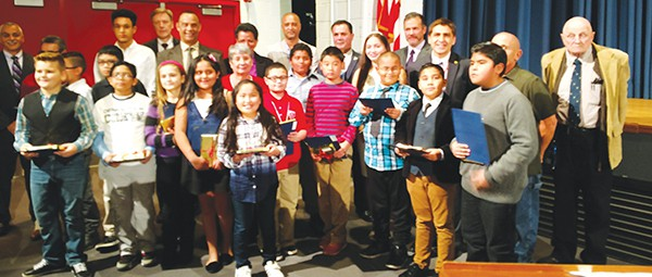 Students who achieved a perfect score on the Science PARCC & NJASK were given recognition by Dr. Damian Medina. Here they pose for a group photo with the Board of Education, Superintendent Dr. David Roman, Assistant Superintendent Mr. Richard Chromey, Board Secretary Derek Jess and Dr. Damian Medina at the 11/17/16 BOE Meeting *Photo by Katherine Massopust
