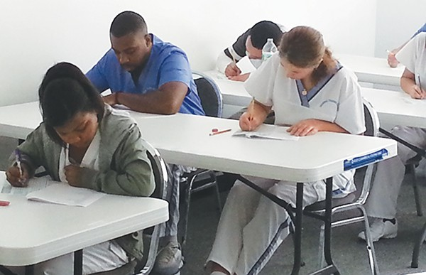 Students working on an exam.
