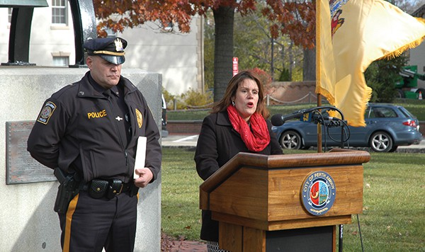 Mayor Wilda Diaz (R) takes a stance on Undocumented Immigrants. Sgt. Richard Zaleski (L) listens as Diaz makes her speech. *Photos by Paul W. Wang