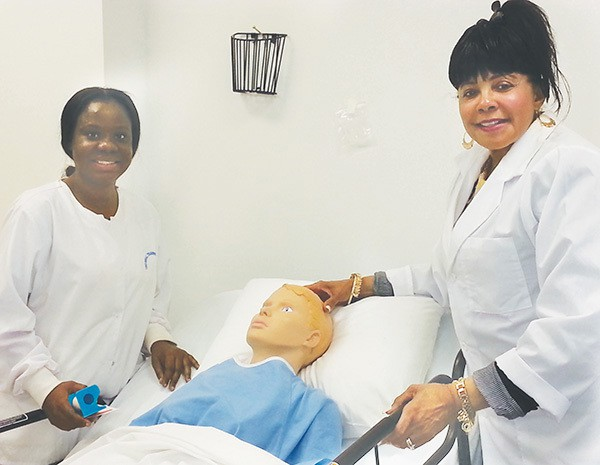 One of the UTI Students (L) and Brenda Dudley (R) show one of the hospital simulation rooms that are used to train students. *Photos by Carolyn Maxwell
